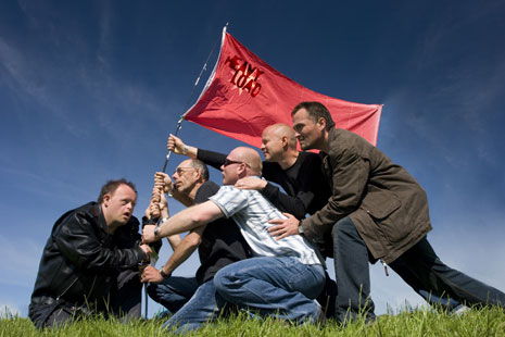 The five members of heavy load raising a red flag (literally)